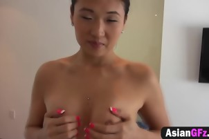 Asian girlfriend deepthroats cock and bangs in doggy style