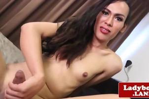Ladyboy beauty with natural boobs solo jerking her uncut cock