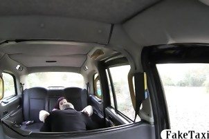 Tattooed redhead babe gets her ass fucked in the taxi