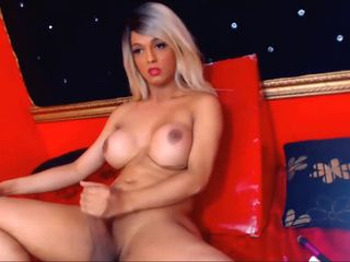 Very Pretty Blonde Shemale With a Hard Cock