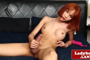 Busty redhead ladyboy beauty solo pulling her hard big cock