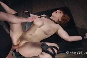 Hogtied redhead caned and fucked in dungeon