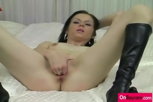 Dark haired babe masturbates with dildo and fingering