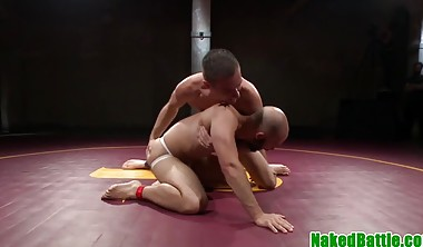 Muscle hunks wrestle before cocksucking and anal fucking