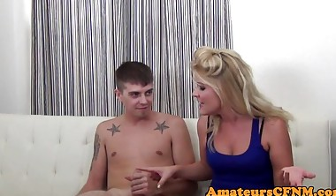 MILF babe sucking subs cock during CFNM scene on the couch