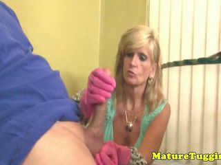 CFNM tugging granny keeps rubber gloves on