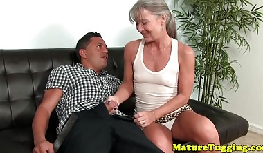 Naughty mature cougar tugging cock till happy ending