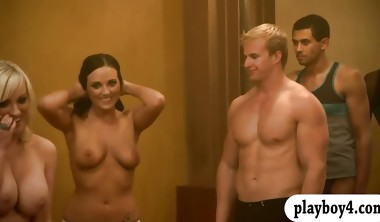 Two girls seducing two men for some cash