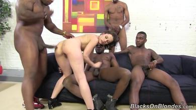 Nikita Bellucci will be plugged by four black dudes