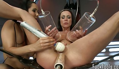 Busty lesbians finger and toy pussys with dildo machine