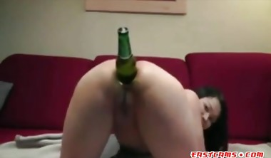 Chubby ass Asian slut fucks her hole with a bottle