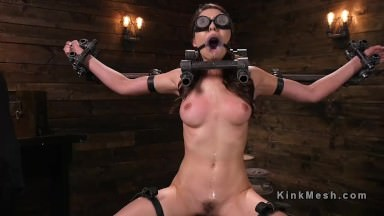 Babe in device bondage drooling