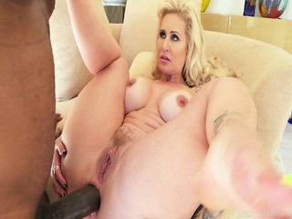 Busty Bitch Jumps On Huge Black Cock
